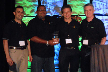 Renato Lezama, Beacon, VP Regional Operations (2nd left) and Christopher Woodhams, Beacon, COO (2nd right), accepting the Customer of the year Award at the 2012 International LANSA User Conference.