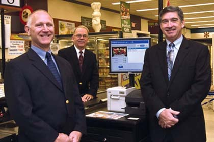 From left to right Joe Jurich, CTO DUMAC with  RORC customers Ron Monahan, owner of Foodland and Glenn Kriczky, VP Information Systems at AWI